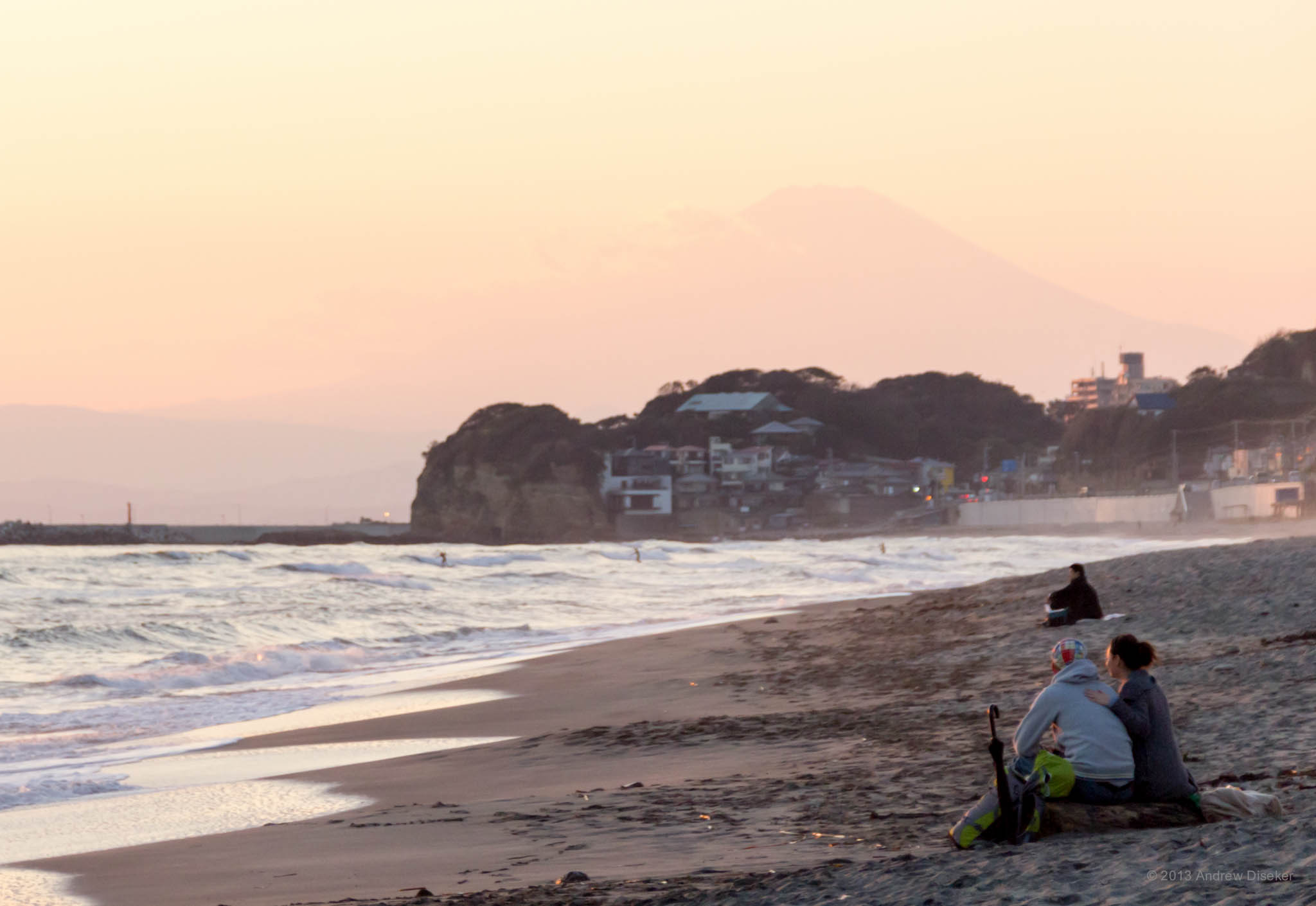 couple on the beach, with Mount Fuji
